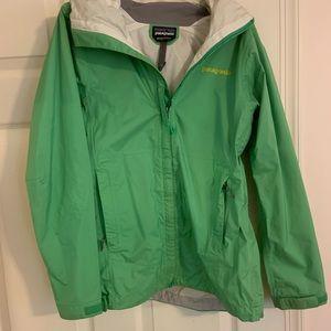 Green Patagonia raincoat